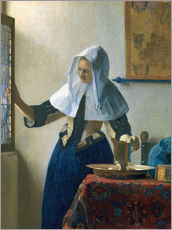 Young woman with a water jug by the window