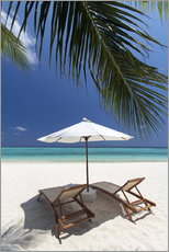 Lounge chairs on tropical beach