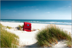 Red beach chair in dunes