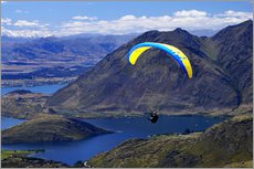 Paraglider above a mountainscape