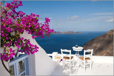 Hotel terrace with pink flowers and stunning views