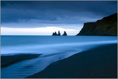 Twilight view towards rock stacks at Reynisdrangar off the coast at Vik, South Iceland, Iceland, Pol