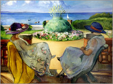 Two women on a terrace by the sea