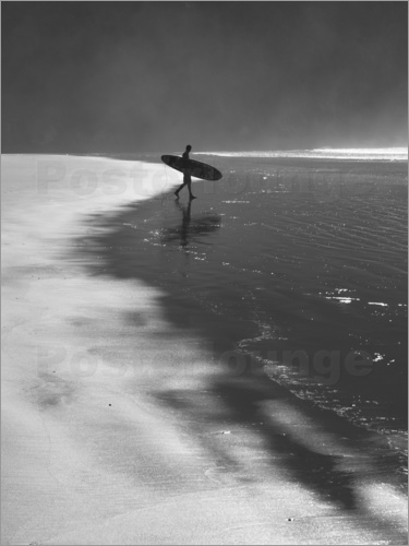 Poster A lone surfer on his way into the sea.