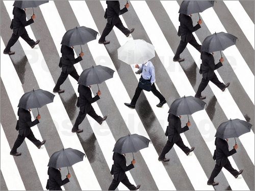 Jan Christopher Becke - Man with umbrella and suit runs as a loner against the tide