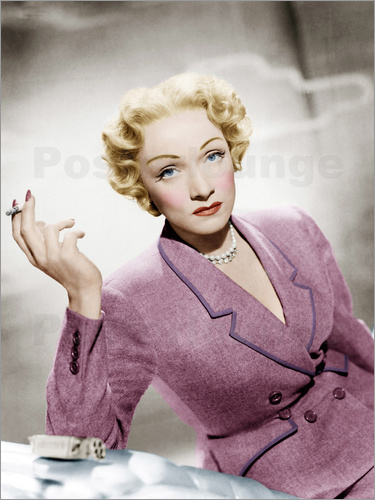 Marlene Dietrich, wearing a suit by Christian Dior