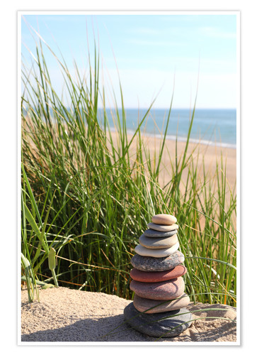 Premium poster A tower of stones on a dune at the sea