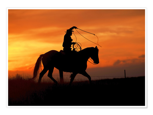 Premium poster Cowboy with horse in the sunset