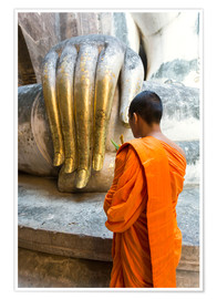 Premium poster Monk praying in front of Buddha Hand
