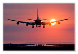 Premium poster Aeroplane landing at sunset