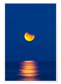 Premium poster Partially eclipsed setting moon