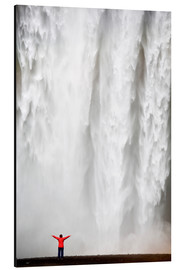 Aluminium print  Woman in red jacket standing in front of Skogafoss waterfall, South Iceland, Iceland, Polar Regions - Lee Frost