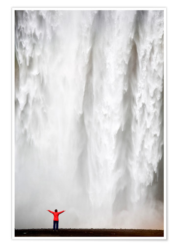 Premium poster Woman in red jacket standing in front of Skogafoss waterfall, South Iceland, Iceland, Polar Regions