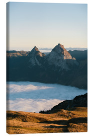 Canvas print  Grosser and Kleiner Mythen mountain peak above cloudscape at sunrise - Peter Wey