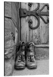 Alu-Dibond  Worn boots before a door - John Short
