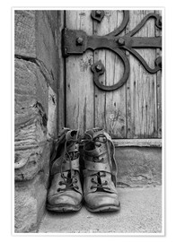 Premium poster  Worn boots before a door - John Short