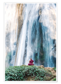 Premium poster Monk meditating at a waterfall