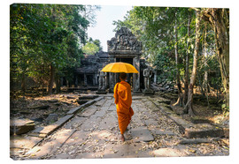 Canvas print  Monk with umbrella walking in Angkor Wat temple, Cambodia - Matteo Colombo