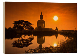 Wood  Shinto statue in sunset