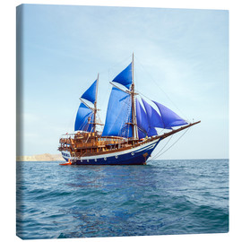 Canvas print  Vintage Wooden Ship with Blue Sails