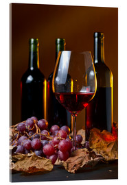 Acrylic glass  red wine with grapes and vine leaves