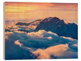 Wood print  Sunrise on a foggy Val di Fassa valley with passo Sella, Dolomites