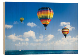 Wood  Colorful hot air balloons on the blue sea
