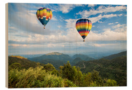 Wood print  Hot air balloon over the mountains