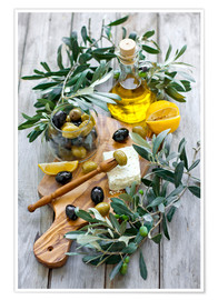 Green and black olives with bottle of olive oil