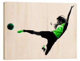 Wood print  Female Footballer jumping