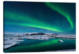 Canvas print  Northern lights dance over glacier lagoon - John Davis