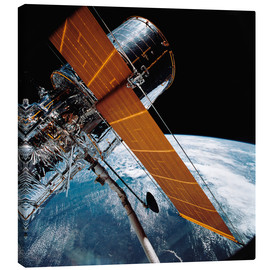 Canvas print  The Hubble Space Telescope backdropped by planet Earth.