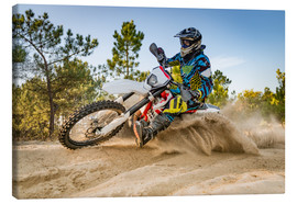 Canvas  Enduro biker on sand terrain