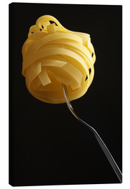 Canvas print  Raw tagliatelle on a fork