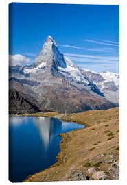 Canvas print  Hikers walking on the path beside the Stellisee with the Matterhorn reflected. Zermatt Canton of Val - Roberto Moiola