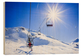 Wood print  Skiers ascending on a ski lift - Gustoimages