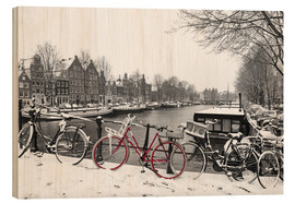 Wood print  Red bicycle in the snow - George Pachantouris