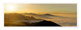 Premium poster Mountain peak over the clouds