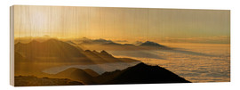Wood print  Mountain peak over the clouds - Michael Rucker