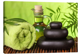 Canvas print  Spa still life with hot stones and essential oil - Elena Schweitzer