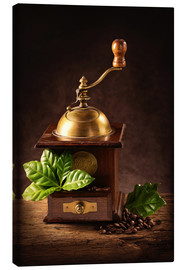 Canvas print  Coffee mill with beans and green leaves and a cup of coffee - Elena Schweitzer