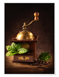 Premium poster Coffee mill with beans and green leaves and a cup of coffee