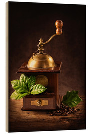 Wood  Coffee mill with beans and green leaves and a cup of coffee - Elena Schweitzer