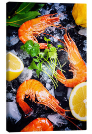 Canvas print  Tiger prawns on ice with lemon and herbs