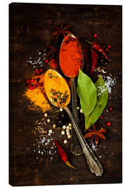 Canvas  Bright spices on an old wooden board