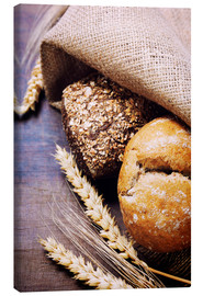 Canvas print  Freshly baked bread on wooden table