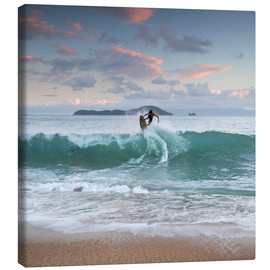 Canvas print  Surfing at sunset in paradise - Alex Saberi