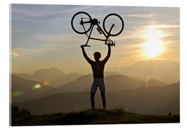 Acrylic print  Man holding a racing bike above his head