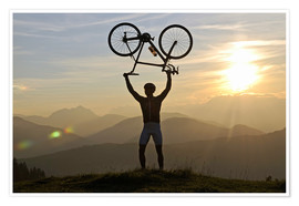 Premium poster  Man holding a racing bike above his head - imageBROKER