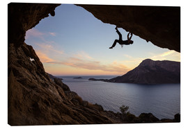 Canvas print  Climber in a cave at sunset